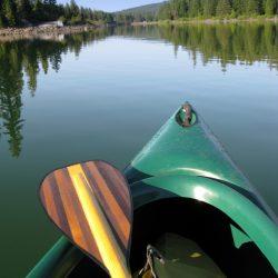 Canoe and Beautiful Wooden Paddle on Lake